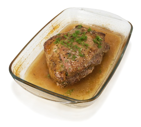 Pork baked with rosemary, garlic and dill on white isolated background Stock Photo