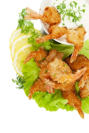 breading: Fried prawns in coconut breading with dipping sauce and dill on white isolated background