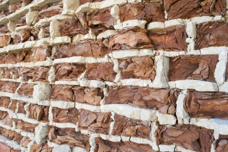 crumbling: Background of old vintage crumbling brick wall Stock Photo