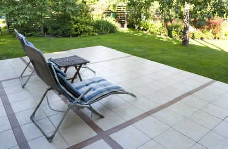 Place to relax on the terrace in the garden as background