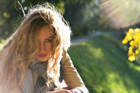 The young beautiful blond woman portrait in autumn park