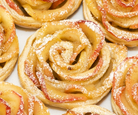 Sweet rolls with apples in the form of roses on plate Stock Photo
