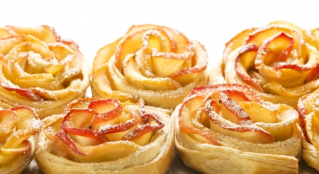 Sweet rolls with apples in the form of roses on white isolated background Stock Photo