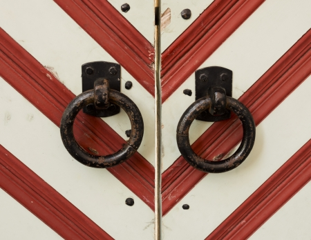 closed society: Forged ring at the gate in a red and white striped