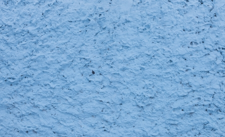 Texture of the light blue roughly plastered wall as background