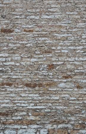 Old vintage limestone wall as background photo