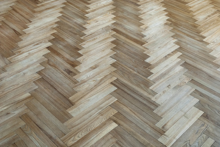 Old parquet with the pattern  fir-tree  photo