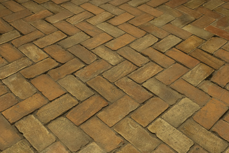 Old vintage paved bricks a floor in the castle as background Stock Photo