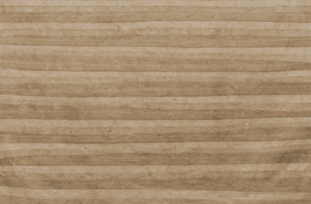 rumpled: Texture of handmade striped rumpled paper sheet  of color of sepia as background