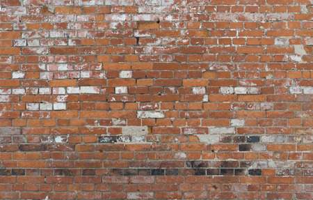 Old vintage brick wall with black bricks as background