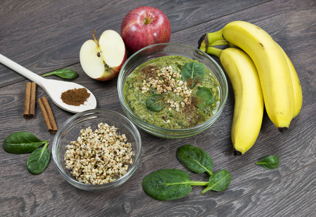 Green smoothie with apples, spinach, banana, germinated buckwheat and cinnamon.Clean eating, fully raw food.