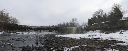 Waterfall Yagala in Estonia in winter. Panorama. February. Stock Photo