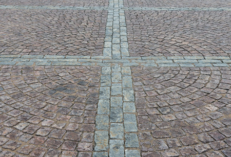 Square cobbled with granite stones as background