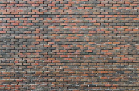 Background of dark vintage brick wall Stock Photo