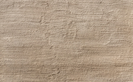 Beige wall stucco texture closeup as background