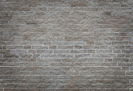 Gray brick wall as background