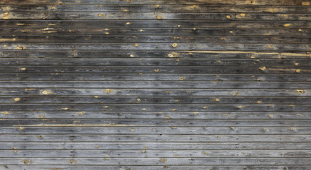 Dark wooden wall  with yellow knots as background