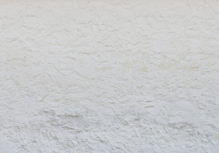 Old vintage white stucco wall with cracks as background, texture Stock Photo
