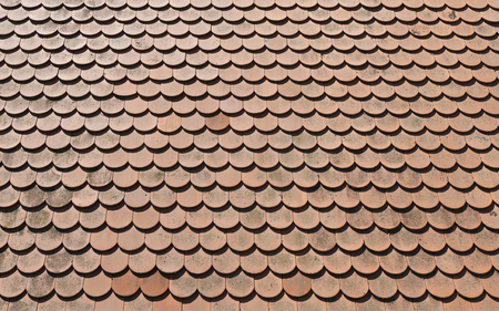 The roof is covered with tiles in sunny day as background Stock Photo