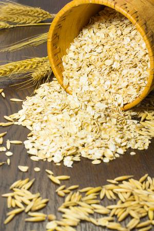 birchbark: Oat flakes in a birchbark basket. Grains of oats and wheat spikelets