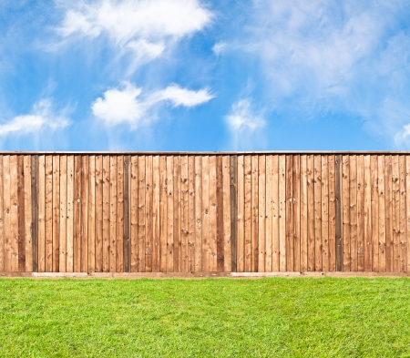 Unlimited endless seamless pattern of the wooden fence at the grass