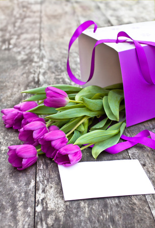 brawn: bouquet of violet tulips pack a on the oak brawn table Stock Photo