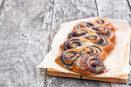 half stuff: Poppy seed roll freshly baked on the table Stock Photo