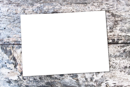 ashy: white sheet of paper on the oak brown table