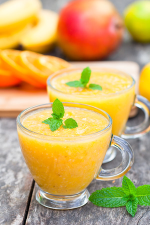 pulpy: fresh healthy pulpy juice with orange fruits and vegetables Stock Photo