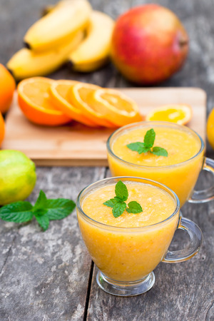pulpy: fresh  healthy pulpy juice with orange fruits and vegetables
