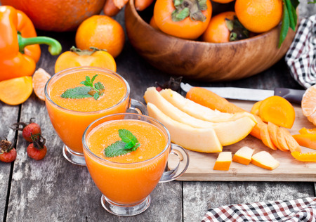 pulpy: fresh healthy pulpy cocktail with orange fruits and berries and vegetables Stock Photo