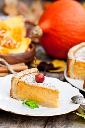 Delicious pumpkin pie with cinnamon decorated with wild apples Stock Photo