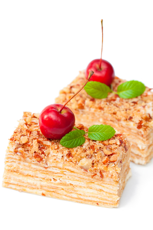 Napoleon cake with wild apples and mint on white background Stock Photo