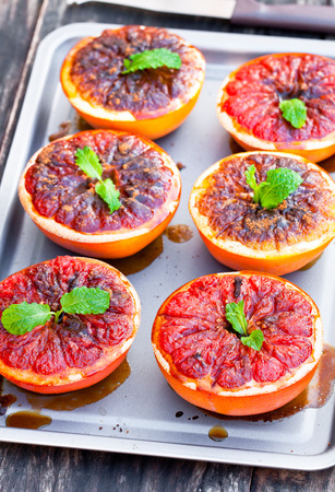 orange peel clove: baked  grapefruit with brown sugar and cinnamon on metal tray