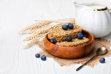 wholegrain: Wholegrain wheat bisks with milk and blueberry