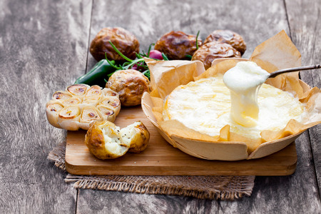 Delicious  baked camembert with roasted potato and garlic