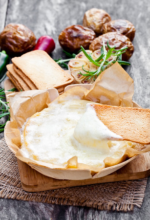 piece paper: Delicious  baked camembert with roasted potato and toast