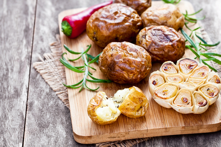 jacked: Delicious  baked potato and garlic with chili and rosemary Stock Photo