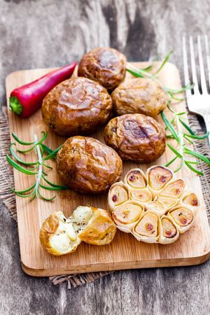 jacked: Delicious  baked potato and garlic with chillie and rosemary Stock Photo