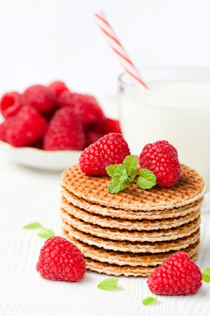 manjar: Stack  of Dutch caramel waffles with fresh raspberry and cup of milk
