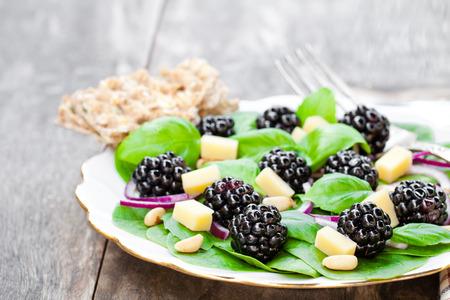 Seasonal  leaf salad with cheese and blackberries