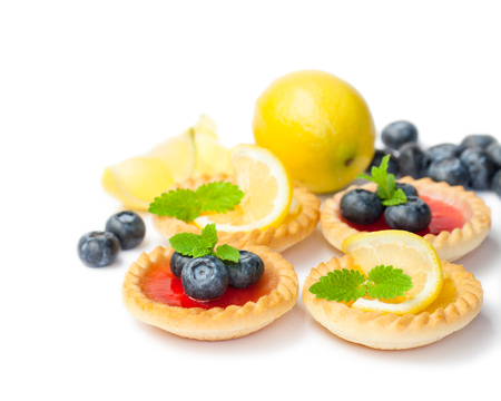 set  of tasty tartlets with lemon and raspberry jam isolated Stock Photo