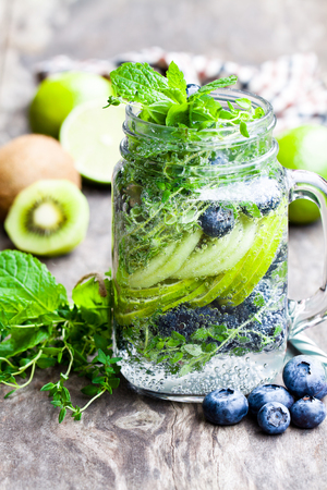 water thyme: Detox  water. Homemade summer fruit drink with lime and kiwi and blueberry