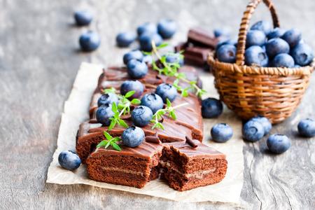 Chocolate  cake with chocolate cream and fresh blueberries