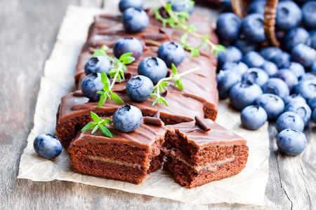 wicker bar: Chocolate  cake with chocolate cream and fresh blueberries