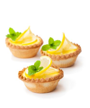 egg  custard tarts with lemon isolated on white
