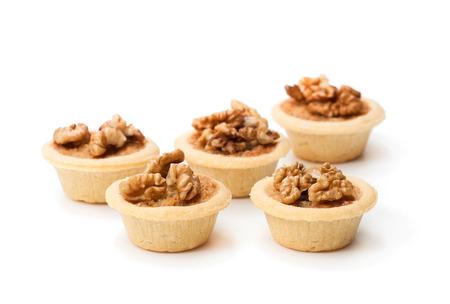mini  ginger and walnut tarts isolated on white