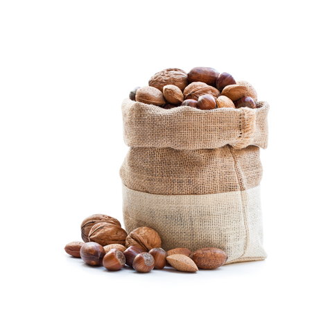 Various  nuts in sackcloth bag isolated on white