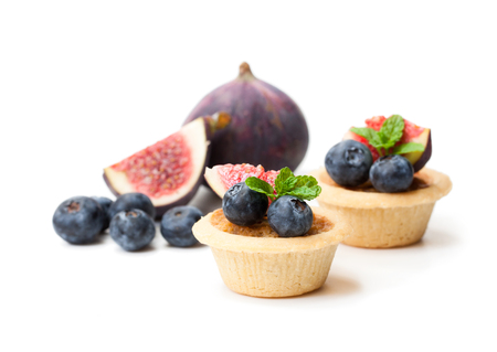 egg  custard tarts with fig and blueberry isolated on white