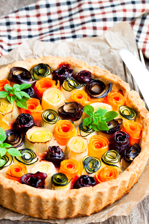 Homemade  vegetarian pie with colored rolled vegetables  Stock Photo